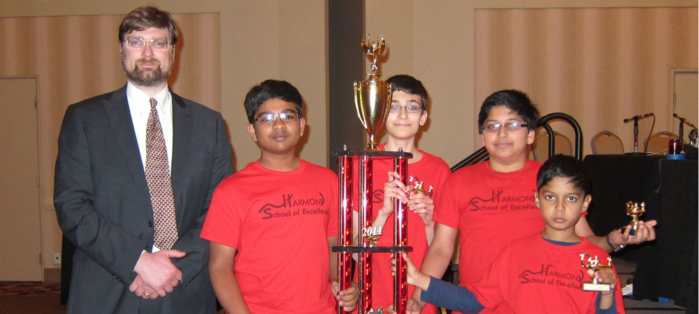 Harmony School of Excellence with their first-place trophy from the 2014 Middle School National Championship Tournament