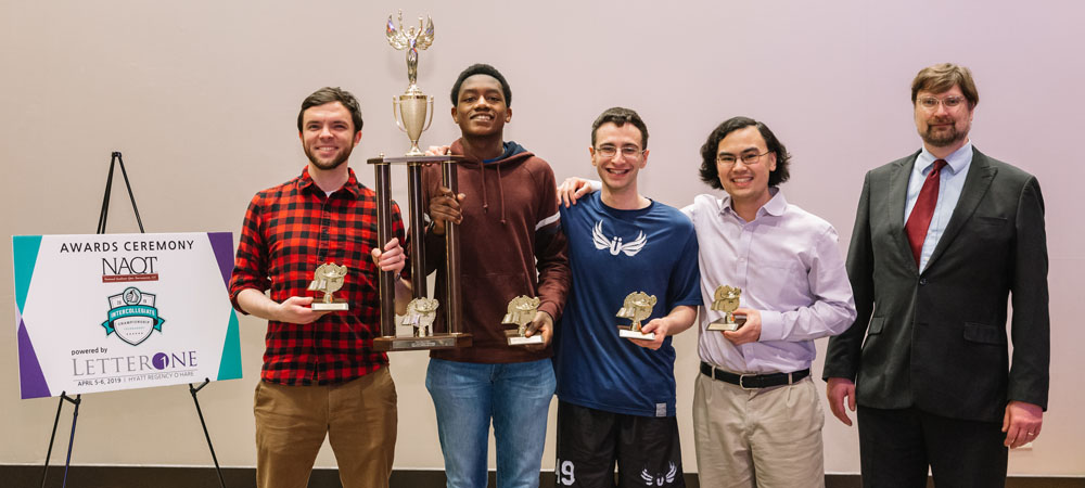 Yale A with their First-Place Division I trophy from the 2019 Intercollegiate Championship Tournament, powered by LetterOne