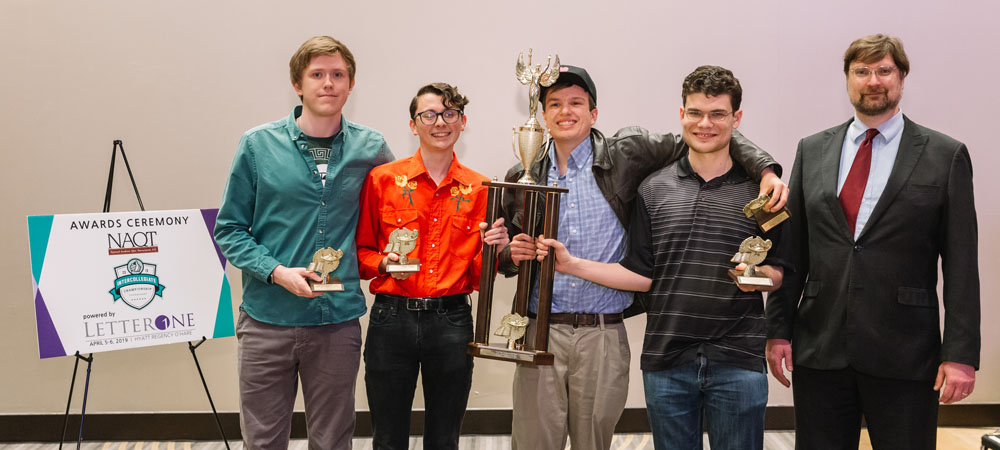 Michigan State with their First-Place Undergraduate trophy from the 2019 Intercollegiate Championship Tournament, powered by LetterOne