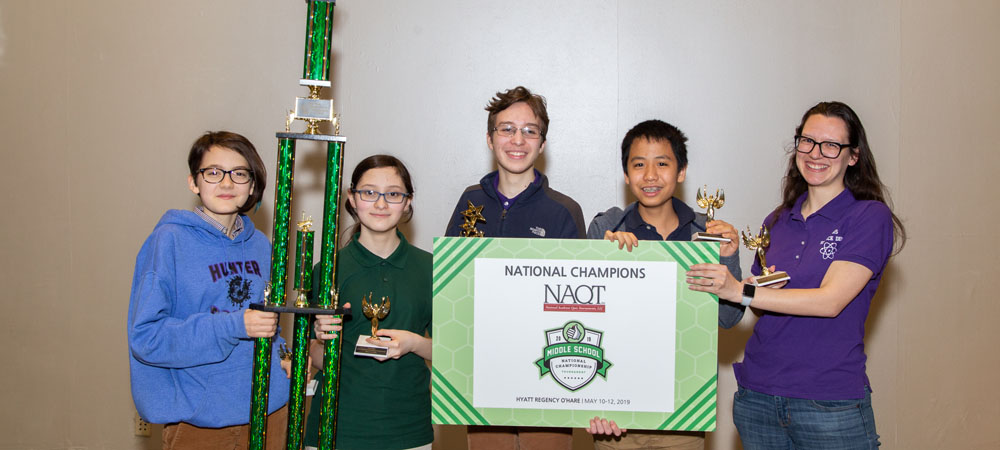 Hunter College High School A with their first-place trophy from the 2019 Middle School National Championship Tournament