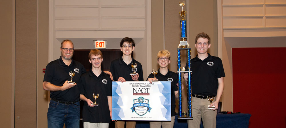 Glasgow A with their First-Place Traditional Public Schools Division trophy from the 2019 Small School National Championship Tournament